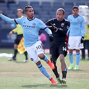 NEW YORK, NEW YORK - March 12:  Yangel Herrera #30 of New York City FC is challenged by Nick DeLeon #14 of D.C. United during the NYCFC Vs D.C. United regular season MLS game at Yankee Stadium on March 12, 2017 in New York City. (Photo by Tim Clayton/Corbis via Getty Images)