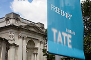 A Tate Britain banner flutters in the breeze, off the shores of the Thames River at Milbank. The Tate, Art gallery, has been divided in to two locations, Tate Britain and Tate Modern. This enables each to specialize in different genres of Art and their collections can have more cohesion. Both galleries have their permanent collection and house visiting exhibitions throughout the year.