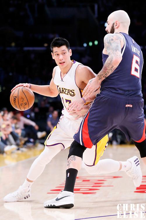 15 March 2015: Los Angeles Lakers guard Jeremy Lin (17) drives past Atlanta Hawks forward Pero Antic (6) during the Atlanta Hawks 91-86 victory over the Los Angeles Lakers, at the Staples Center, Los Angeles, California, USA.