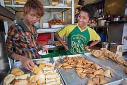 Asia, Myanmar, Burma, Yangon, teen boys selling snacks