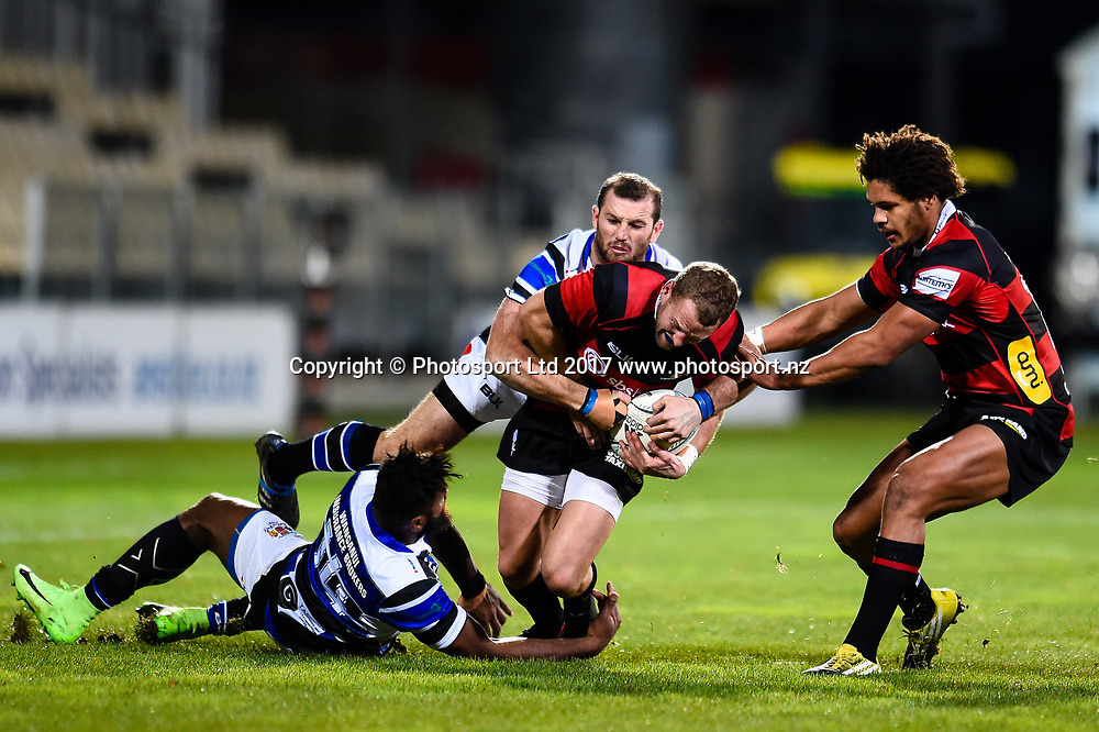Mark Maitland of Canterbury is tackled by Samu Kubunavanua of Wanganui and Cameron Crowley of Wanganui with Michael Green of Canterbury in support during the Ranfurly Shield Rugby Match, Canterbury V Wanganui, AMI Stadium, Christchurch, New Zealand, 10th June 2017.Copyright photo: John Davidson / www.photosport.nz