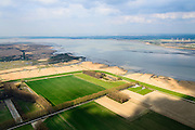 Nederland, Zeeland, Zeeuws-Vlaanderen, 01-04-2016; Hertoging Hedwige polder gezien naar Verdronken Land van Saeftinghe. In verband met de verdieping van de vaargeul van de Westerschelde (recjts) moet er volgens de Europese habitatrichtlijn natuurcompensatie komen. Door de polders te ontpolderen wordt er grond terug gegeven aan de natuur, zogenaamde natuurcompensatie. <br /> Hertogin Hedwige polder has to be de-poldered, because of the enlargement of the fairway of the nearby Scheldt, the nature has to be compensated (according to the European Habitats Directive), the measures are controversial.