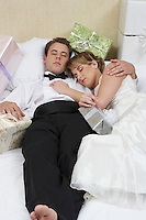 Bride and groom sleeping among presents