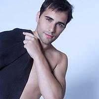 studio shot on isoltaded background portrait of handsome man in bathrobe