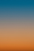 The sunset colors as seen from Waikiki. Vertical.