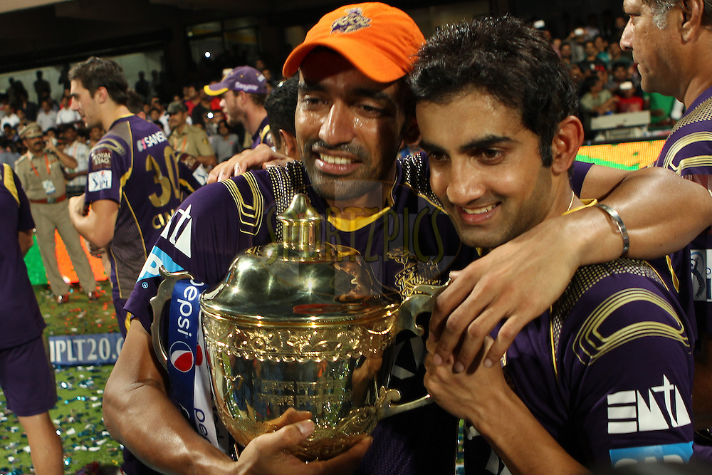 Robin Uthappa of the Kolkata Knight Riders and Gautam Gambhir captain of the Kolkata Knight Riders celebrate thew win during the final match of the Pepsi Indian Premier League Season 2014 between the Kings Xi Punjab and the Kolkata Knight Riders held at the M. Chinnaswamy Stadium, Bangalore, India on the 1st June  2014<br /> <br /> Photo by Ron Gaunt / IPL / SPORTZPICS<br /> <br /> <br /> <br /> Image use subject to terms and conditions which can be found here:  http://sportzpics.photoshelter.com/gallery/Pepsi-IPL-Image-terms-and-conditions/G00004VW1IVJ.gB0/C0000TScjhBM6ikg