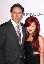 'The Frozen Ground' London Premiere.<br /> Nicolas Cage arrives with his wife Alice Kim at the Premiere of their latest film ''The Frozen Ground', in London's Leicester Square,<br /> London, United Kingdom<br /> Wednesday, 17th July 2013<br /> Picture by i-Images