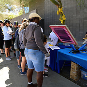 Poetry aficionados line up for free tee shirts printed with verse.