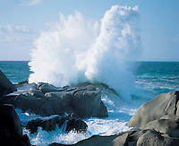 Waves crashing on rocks at coast