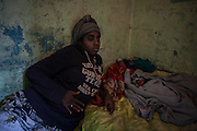 A 15 years old prostitute, with her child born to a few days. As a result of abuse suffered by a client she got pregnant with twins, one died a few hours after birth.<br /> <br /> Addis Ababa, Ethiopia, 07-03-2013.<br /> <br /> To protect the identities of the recorded subjects names are omitted