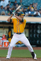June 29, 2011; Oakland, CA, USA; Oakland Athletics right fielder Conor Jackson (28) at bat against the Florida Marlins during the first inning at the O.co Coliseum.  Florida defeated Oakland 3-0.