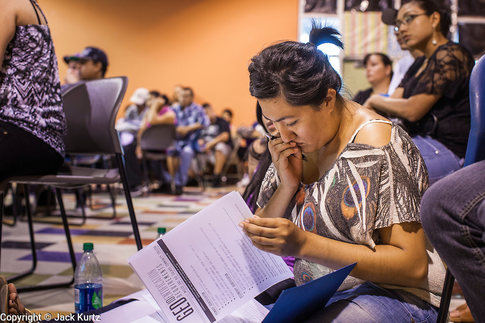 "18 AUGUST 2012 - PHOENIX, AZ:  A young woman goes over the paperwork needed to get into a local community college and qualify for ""deferred action"" status during a deferred action workshop to start in Phoenix. More than 1000 people attended a series of 90 minute workshops in Phoenix Saturday on the ""deferred action"" announced by President Obama in June. Under the plan, young people brought to the US without papers, would under certain circumstances, not be subject to deportation. The plan mirrors some aspects the DREAM Act (acronym for Development, Relief, and Education for Alien Minors), that immigration advocates have sought for years. The workshops were sponsored by No DREAM Deferred Coalition.  PHOTO BY JACK KURTZ"
