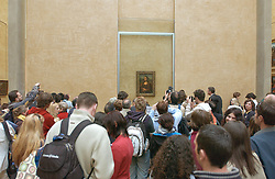 Musee du Louvre's master piece, Monna Lisa La Joconde by Leonardo da Vinci was moved inside the Museum to a larger room on April 5, 2005. Da Vinci's chef d'Oeuvre is now facing the biggest painting of the Louvre, the famous Noces De Cana by Veronese. Photo by Giancarlo Gorassini/ABACA.  | 76085_06