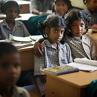 Viyashree Viswanathan (centre with large bindi on forehead) in her 5th Standard class at the Thalanuda Government School. Vijyashree's grades have been falling in recent months. The benches on which Vijyashree and her fellow students work were supplied by Unicef following the tsunami.<br />