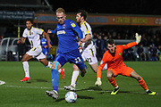 AFC Wimbledon midfielder Mitchell (Mitch) Pinnock (11) rounding Burton Albion goalkeeper Kieran O'Hara (1) to score goal during the EFL Sky Bet League 1 match between AFC Wimbledon and Burton Albion at the Cherry Red Records Stadium, Kingston, England on 28 January 2020.
