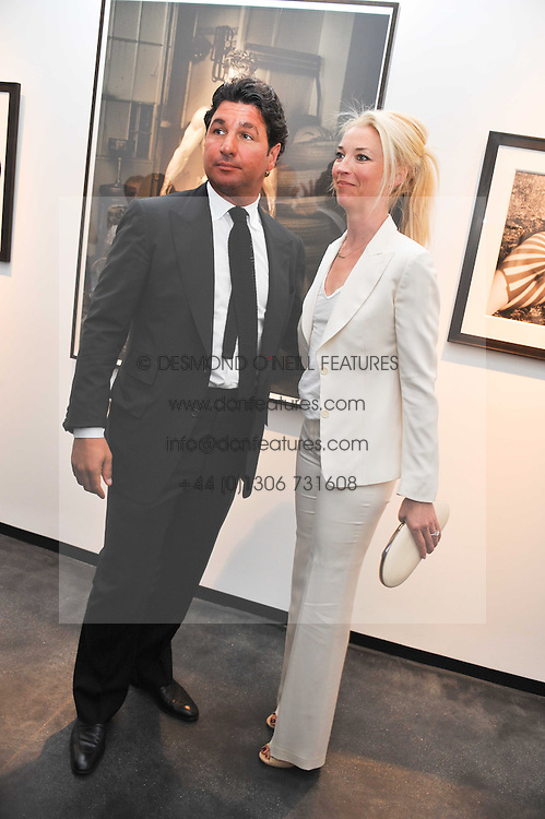 GEORGIO VERONI and TAMARA BECKWITH at a private view of photographs by Herb Ritts held at Hamiltons Gallery, 13 Carlos Place, London on 21st June 2011.