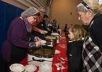 "Paula Giles serves Caroline and Barbara Goren a bowl of Japanese Udon Noodle soup during Hands Across the Table's ""Soupathon"" Sunday evening.  (Karen Bobotas/for the Laconia Daily Sun)"