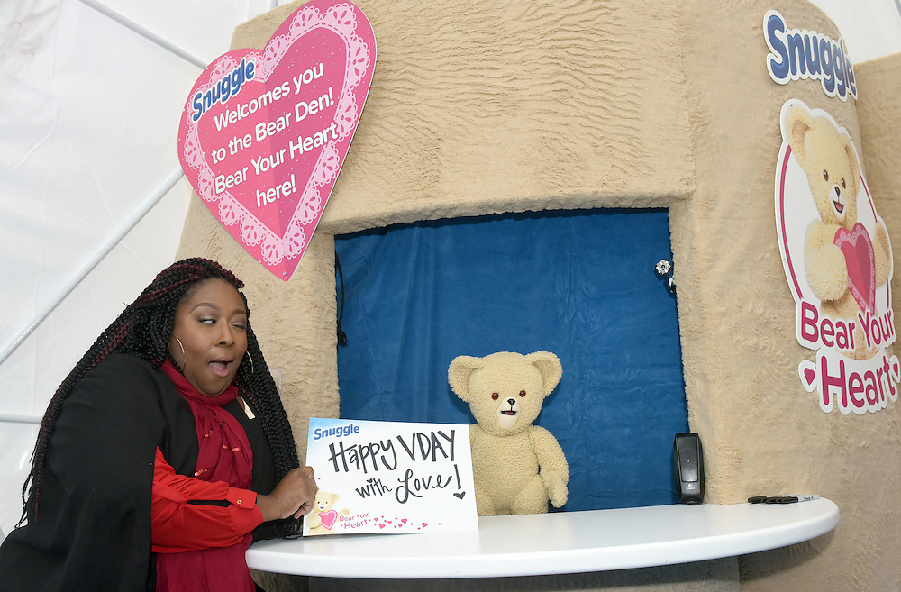 Comedian and TV host Loni Love celebrates Valentine's Day with Snuggle Bear at the Snuggle Bear Den in New York, Thursday, Feb. 11, 2016.  Snuggle is helping people express their heartfelt emotions at the #BearYourHeart event. (Diane Bondareff/AP Images for Snuggle)