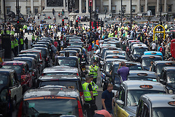 Image ©Licensed to i-Images Picture Agency. 11/06/2014. London, United Kingdom. Drivers of London black cabs \'gridlock\' the area around Whitehall. Drivers of black cabs 'gridlock' the area around Trafalgar Square and government buildings on Whitehall in a protest against the Uber app-based service. Whitehall, London. Picture by Daniel Leal-Olivas / i-Images