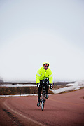 kevin Brady biking in rain and fog South of Vermillion, SD on March 10, 2010..