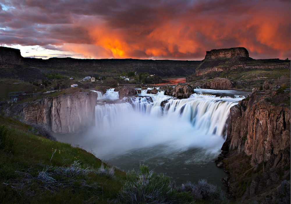 Setting sun paints the clouds with light over Shoshone Falls near Twin Falls, Idaho.