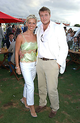 ALEX & KIRSTY RAYNER at the 2005 Cartier International Polo between England & Australia held at Guards Polo Club, Smith's Lawn, Windsor Great Park, Berkshire on 24th July 2005.<br />