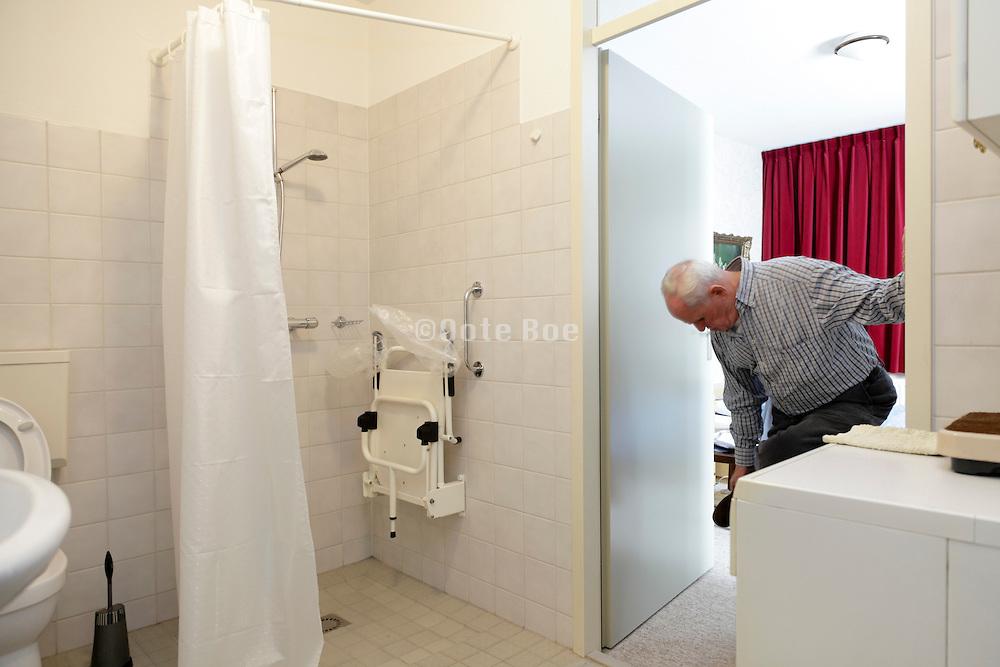 senior man getting him self ready for a shower
