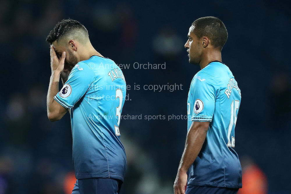 Swansea city players Neil Taylor (l) and Wayne Routledge walk off dejected at the end of the game after losing the match.  Premier league match, West Bromwich Albion v Swansea city at the Hawthorns stadium in West Bromwich, Midlands on Wednesday 14th December 2016. pic by Andrew Orchard, Andrew Orchard sports photography.