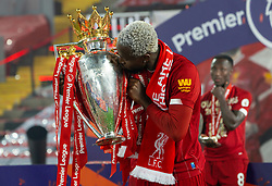 LIVERPOOL, ENGLAND - Wednesday, July 22, 2020: Liverpool's Divock Origi kisses with the Premier League trophy as the Reds are crowned Champions after the FA Premier League match between Liverpool FC and Chelsea FC at Anfield. The game was played behind closed doors due to the UK government's social distancing laws during the Coronavirus COVID-19 Pandemic. (Pic by David Rawcliffe/Propaganda)