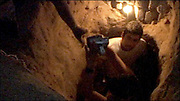 "Cameraman and co-director of Tunnel Trade, Saeed Taji Farouky, heads underground to film inside ""Ibrahim's"" tunnel."