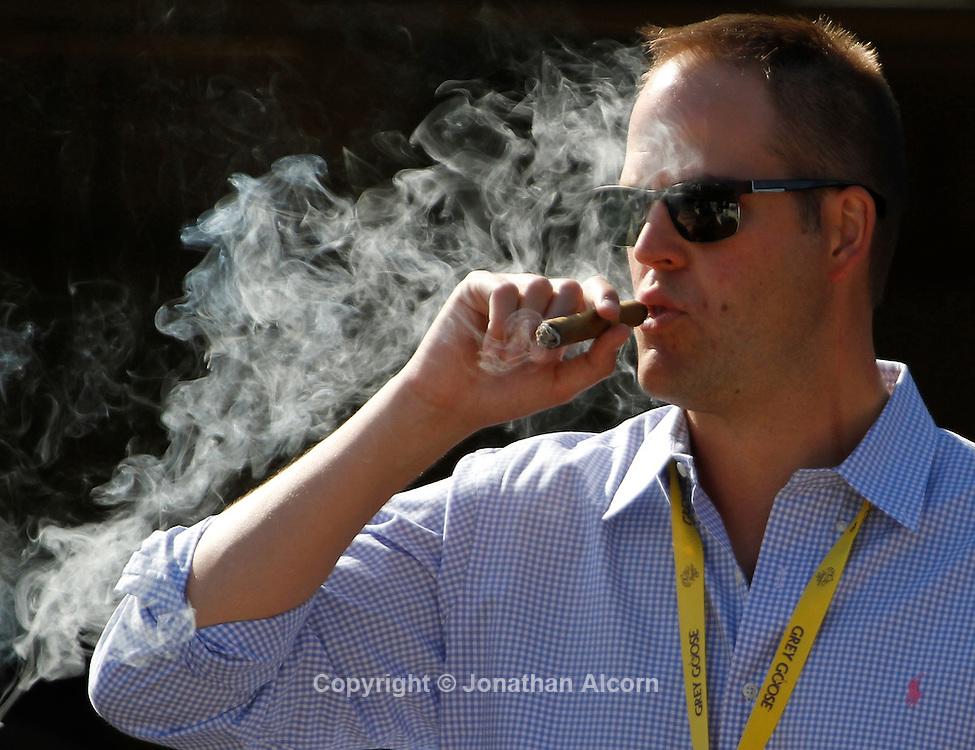 Smoking a cigar at the 2012 Breeders' Cup World Championships at Santa Anita Park in Arcadia, CA, November 3, 2012. UPI/Jonathan Alcorn