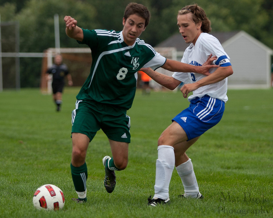 West Deptford's Kyle Redrow pushes Sterling's JT Harding off the ball in the 1st half during the first match of the season at Sterling High School on Thursday September 8, 2011.
