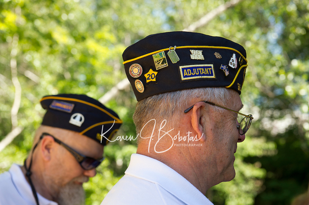 Past commander Steve Bracy and Adjutant Woodbury Fogg during the American Legion VFW Post 58 flag retirement ceremony at Belmont's covered bridge on Saturday afternoon.  (Karen Bobotas/for the Laconia Daily Sun)