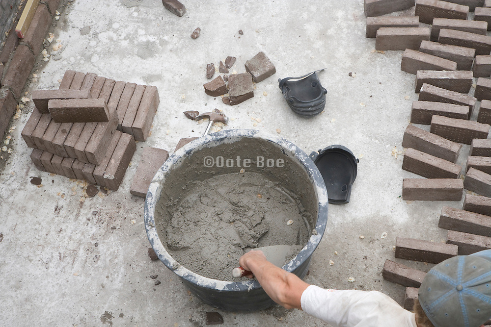overhead view of bricklayer at work