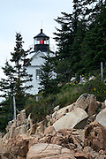 View of Bass Harbor Head Lighthouse in Acadia National Park, Maine from the rocky coastline below