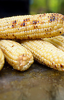 Corn on the cob cooked on the grill.