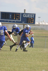 14 August 2004   Storms Derek Overton begins a run back after intercepting the ball.   Twin City Storm V Capitol City Outlaws, Midwest Football League, Interstate Center, Bloomington-Normal IL
