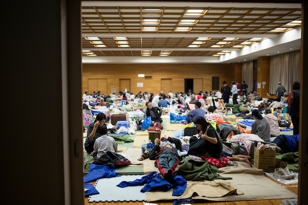 KUMAMOTO, JAPAN - APRIL 19 : Residents are seen at the Mashiki Town Gymnasium evacuation center on April 19, 2016 in Mashiki town, Kumamoto, Japan. At least 41 people were killed and over 180,000 people were evacuated in the series of earthquakes hitting southwestern Japan since 14 April 2016.