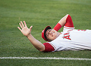 The Angels' Mike Trout waves to a friend while being stretched before the game Wednesday night at Angel Stadium.