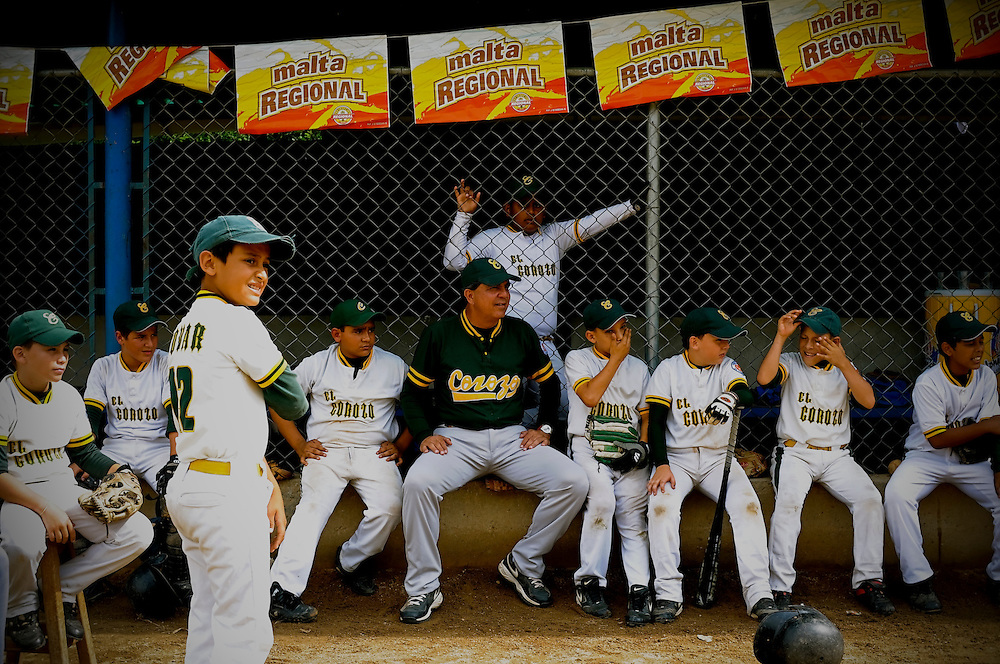 Luis Morales (center) coaches the Tovar little league team, El Corozo, during their championship game, Saturday, Dec. 12, 2009 in Tovar, Venezuela. Morales was Mets' Johan Santana's little league coach before he was discovered in 1994 by Houston Astro's scout Andrés Reiner.