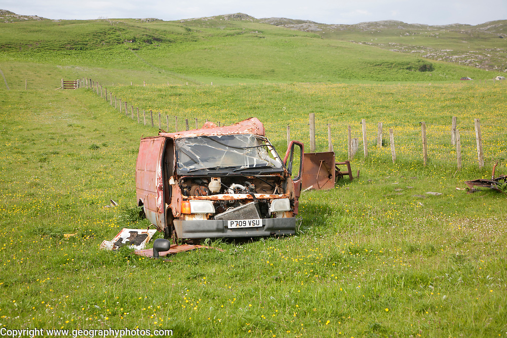 Wrecked vehicle in field, Barra, Outer Hebrides, Scotland, UK