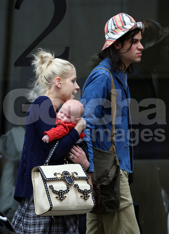 Peaches Geldof, fiancé Thomas Cohen and son Astala visit The Portland Hospital for Women and Children outpatients in Great Porland Street. As the pair arrived at the hospital, Peaches was kissing and holding Astala, as for Thomas he looked to have his hands full with a shoulder bag, Peaches handbag, bottle of milk, baby carrier and holding onto their beloved dog Parpy. Peaches wearing a blue cardigan, black top and a long checked skirt left the hospital about half an hour later and got a taxi to Berkeley Square for their dog Parpy to have a quick run around, before heading home. London, UK. 03/07/2012 <br />BYLINE MUST READ : JAMESY/GOTCHA IMAGES<br /><br />Copyright by © Gotcha Images Ltd. All rights reserved.<br />Usage of this image is conditional upon the acceptance <br />of Gotcha Images Ltd, terms and conditions available at<br />www.gotchaimages.com