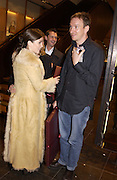 Anna Friel and David Thewlis with party favours. . Re-opening of Mulberry. New Bond St. London. 23 October 2001. © Copyright Photograph by Dafydd Jones 66 Stockwell Park Rd. London SW9 0DA Tel 020 7733 0108 www.dafjones.com