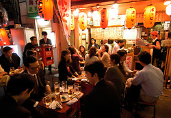 Restaurant at night below railway tracks at Yurakucho in central Tokyo