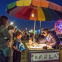 A street artist at the Santa Monica Pier on Saturday night, July 19, 2014.