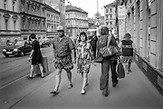 Residents walking Konevova street in Zizkov.