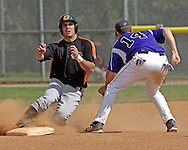 Oklahoma State's Keanon Simon (L) slides into second base with a stolen base, before Kansas State second basemen Brett Scott (R) can make the tag in the top of the tenth inning.  Oklahoma State defeated K-State 9-4 in 10 innings at Tointon Stadium in Manhattan, Kansas, April 30, 2006.
