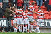 Doncaster celebrate Richard Chaplow of Doncaster Rovers goal to go 2-1 up during the Sky Bet League 1 match between Doncaster Rovers and Barnsley at the Keepmoat Stadium, Doncaster, England on 3 October 2015. Photo by Ian Lyall.