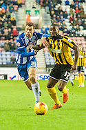 Yanic Wildschut of Wigan Athletic is held up by Abu Ogogo of Shrewsbury Town during the Sky Bet League 1 match at the DW Stadium, Wigan<br /> Picture by Matt Wilkinson/Focus Images Ltd 07814 960751<br /> 21/11/2015