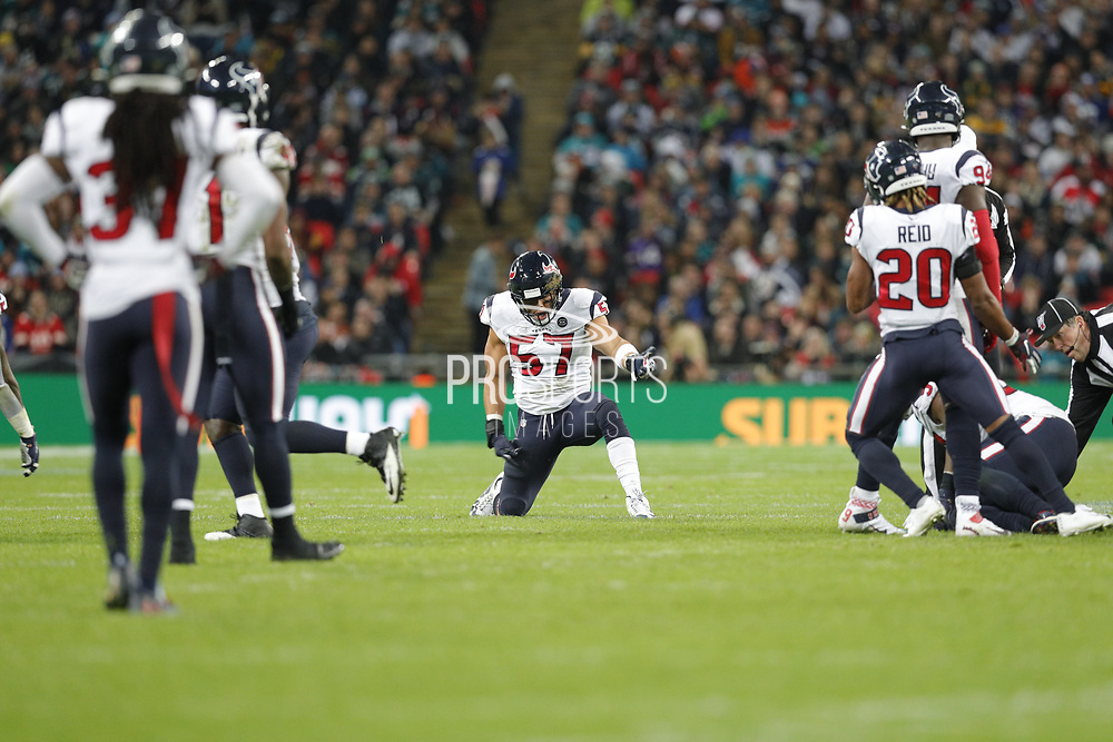Houston Texans Linebacker Brennan Scarlett (57) air guitar moves after a 4th down during the International Series match between Jacksonville Jaguars and Houston Texans at Wembley Stadium, London, England on 3 November 2019.